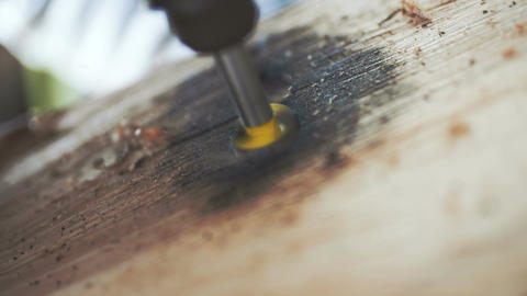 Drilling hole onto wood - Slowmotion Footage