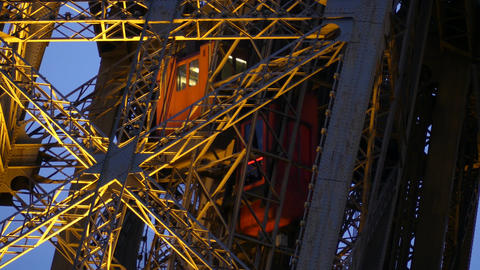 Moving elevator of the Eiffel tower in Paris. Telephoto lens shot Footage