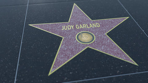 Hollywood Walk of Fame star with JUDY GARLAND inscription. Editorial clip Live Action