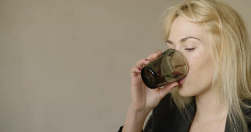 Businesswoman drinking water at desk in office Footage