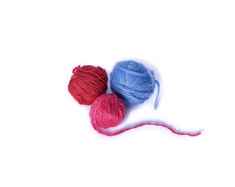 three multicolored woolen tangle for knitting Foto