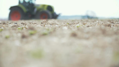 AGRICULTURE - Slowmo shoot of Agricultural tractor sowing and cultivating field Footage