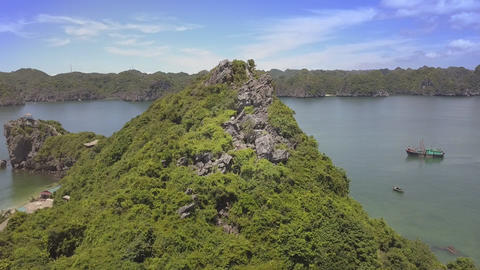 Drone Flies to Hill Top with Girl Figure on Large Sharp Rocks Footage