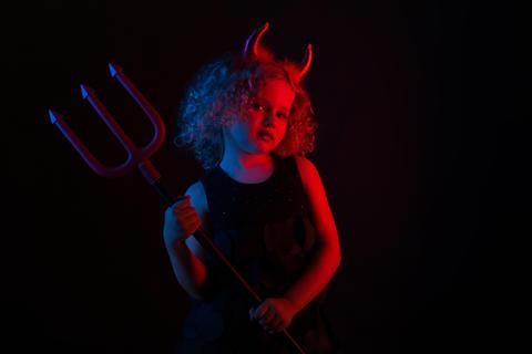 Cute girl in devil costume Fotografía