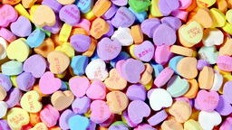 Rotating Valentine candy hearts Footage