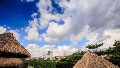 Clouds Motion in Sky above City Park Reed Sun Umbrellas Footage