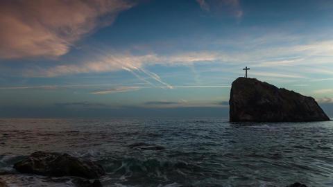 Cross on a rock in the sea Footage