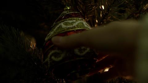 Woman decorate on Christmas tree with Christmas ball Footage