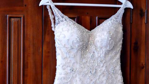 top to bottom shot of wedding dress ビデオ