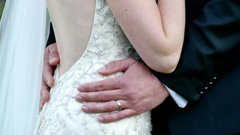 shot of bride & groom holding each other Footage