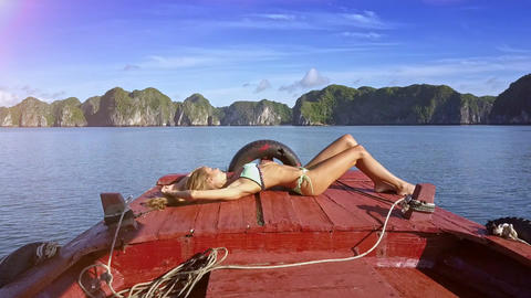 Attractive Woman Lays and Takes Sunbathe against Quite Bay Footage