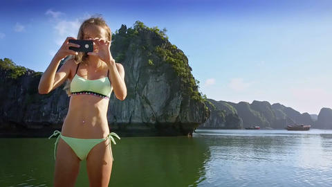 Young Sexy Woman Photos with Iphone and Sails on Boat Footage