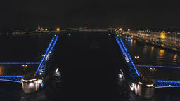Bridge with illumination over the river at night Footage