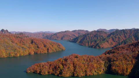 Aerial - Autumn mountain seen from the sky above the lake Archivo