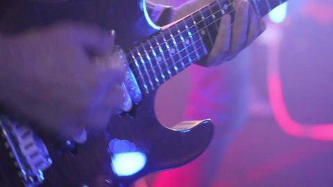 Playing on guitars close-up Footage