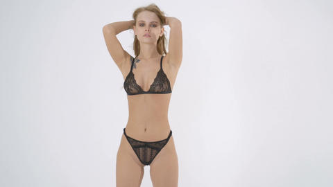 sexy blonde woman posing wear in black lingerie, bra and panties. Studio Footage