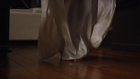 Closeup of high heels and silky robe dropping to floor 2 Footage