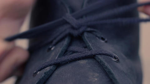 Tying shoelaces closeup Footage
