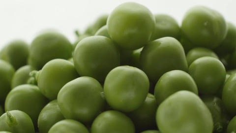 Fresh green peas rotate. Close up Footage
