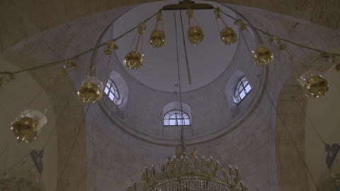 Ornate chandelier in an ancient building/temple Footage
