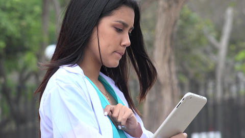 Young Female Nurse Using Tablet Live Action