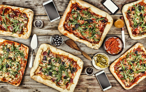 Appetizing homemade pizza on a wooden table. Friendly feast at home Photo