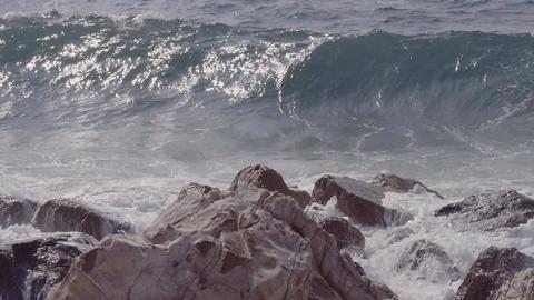 Waves crashing on rocks and splashing background Footage
