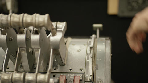 Closeup of hand pulling lever in a cockpit Live Action