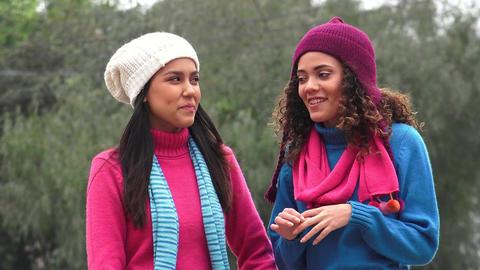 Hispanic Girls Friends Talking Wearing Sweaters Live Action