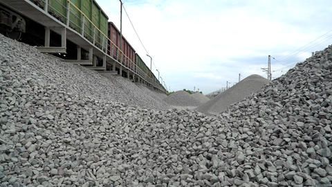 Railway. Transportation of crushed stone by rail. Unloading railway platform Footage