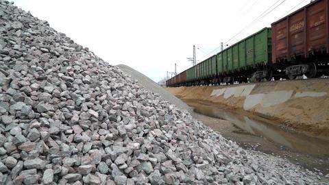 Railway. Transportation of crushed stone by rail. Unloading railway platform Footage