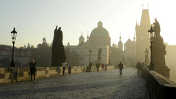 Charles Bridge With People Walk - Sunrise - City - Morning Mist - Buildings With stock footage