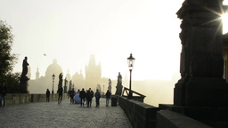 Charles bridge with people - sunrise - city - morning mist - buildings with stat Footage