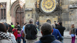 group of tourists watch the Astronomical Clock Footage