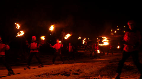 Skiers With Torches stock footage