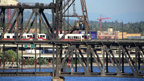 Light Rail Passing over Steel Bridge Footage