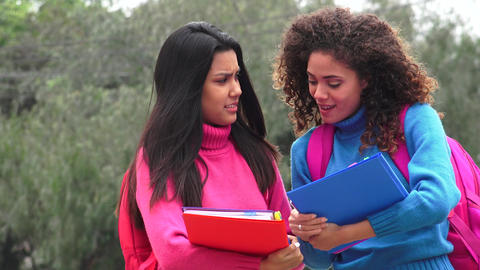 Female Teen Students With Notebooks Live Action