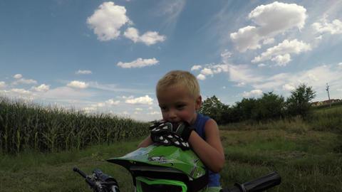 A little boy rides his electric ATV quad Footage