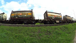 Cargo train passing, low angle Footage