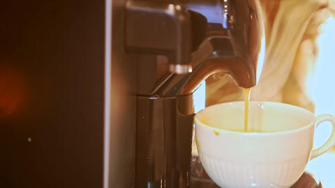 Macro Coffee Jet Pours into Cup from Coffee Machine Footage