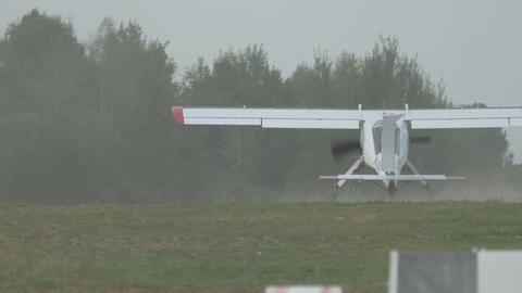 Small vintage aircraft just landed on the field Footage