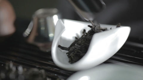 Close up shot of aromatic premium black tea leaves pile on white scoop Footage