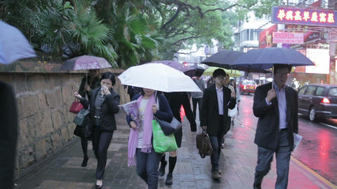 China, Hong Kong - 04 March 2015: People under the Rain Walking on the Street Footage