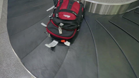 Waiting for the baggage near the belt conveyor at the baggage claim area Footage