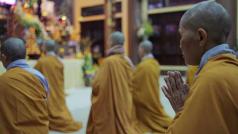 Hanoi, Vietnam - March 8, 2015: Buddhist Monks Pray In Temple Footage