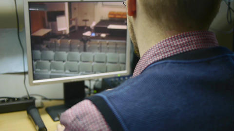 Man working with security surveillance monitor Footage