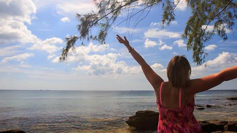 Backside Blond Girl Puts Hands behind Head on Sea Beach Footage