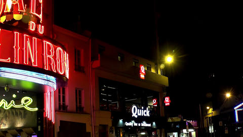 The Moulin Rouge cabaret at night. Paris. France Footage