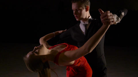 Young ballroom dance couple preform exhibition dance in studio Footage