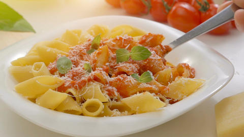 Hot Pasta with tomato Sauce, Parmesan Cheese and Basil on a Spoon Footage